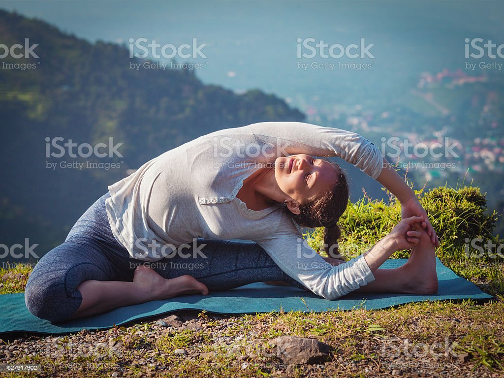 Young sporty fit woman doing Hatha Yoga asana stock photo