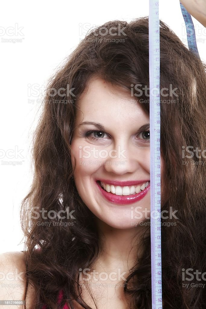 young sporty fit woman with measure tape royalty-free stock photo