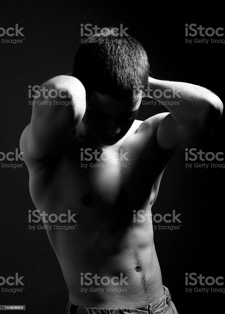 B&W young sporty man over black background royalty-free stock photo
