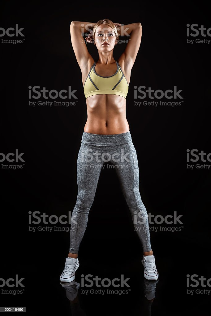 Young sporty well formed woman stock photo