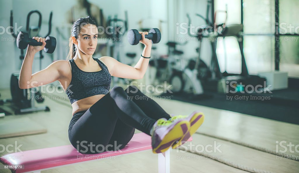 young sporty woman exercise at the gym stock photo