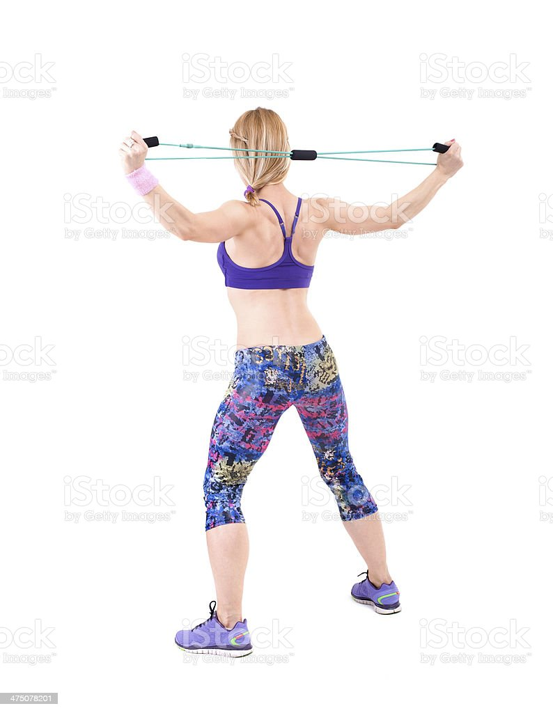 Young sporty woman exercising with a resistance rope royalty-free stock photo