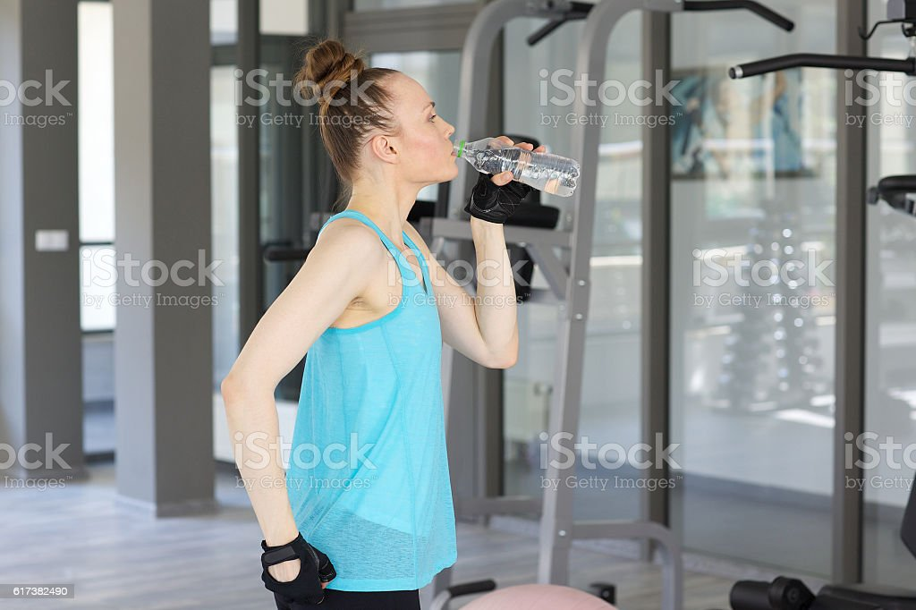 Young spotty woman drinks water stock photo