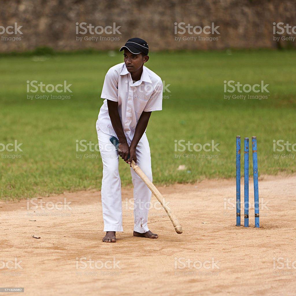 Young Sri Lankan schoolboys playing cricket royalty-free stock photo