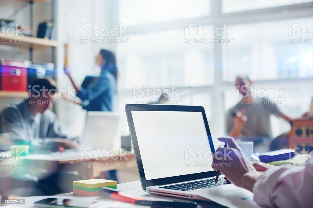 Young startup group working in loft office stock photo