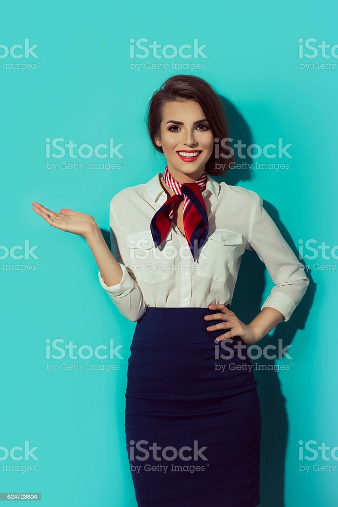young stewardess business woman in dark blue suit standing stock photo