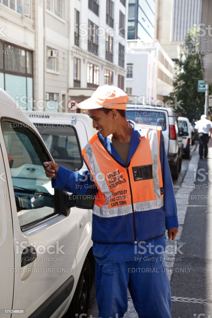 Young street parking operative in Cape Town royalty-free stock photo