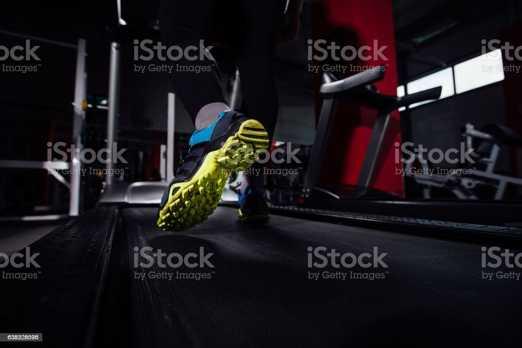 Young strong big man fitness model in the gym running stock photo