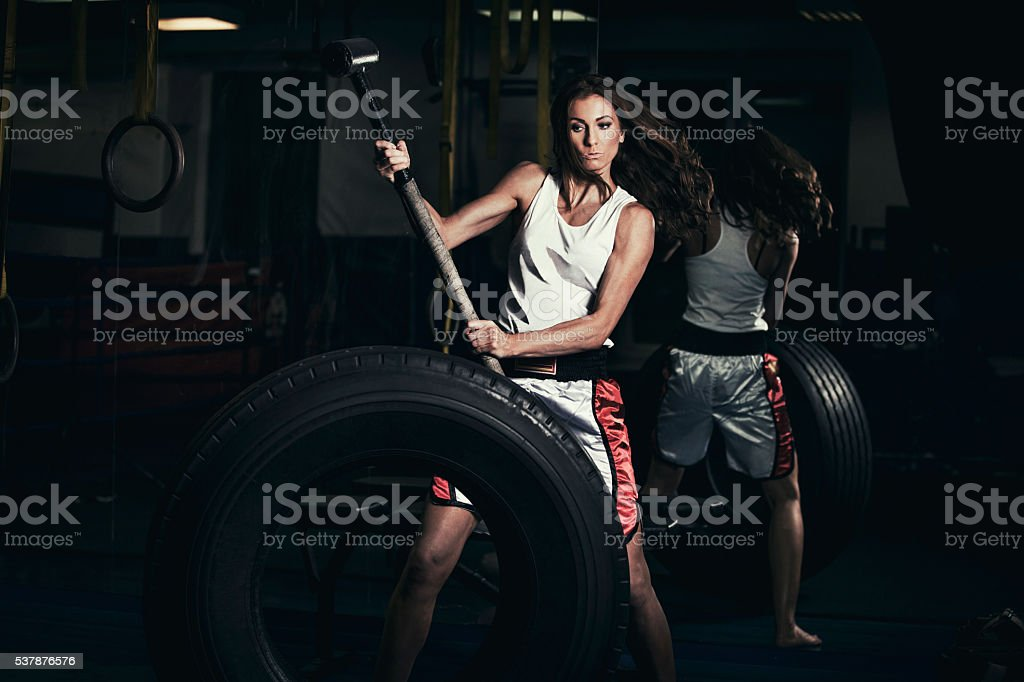 Young strong woman cross training stock photo