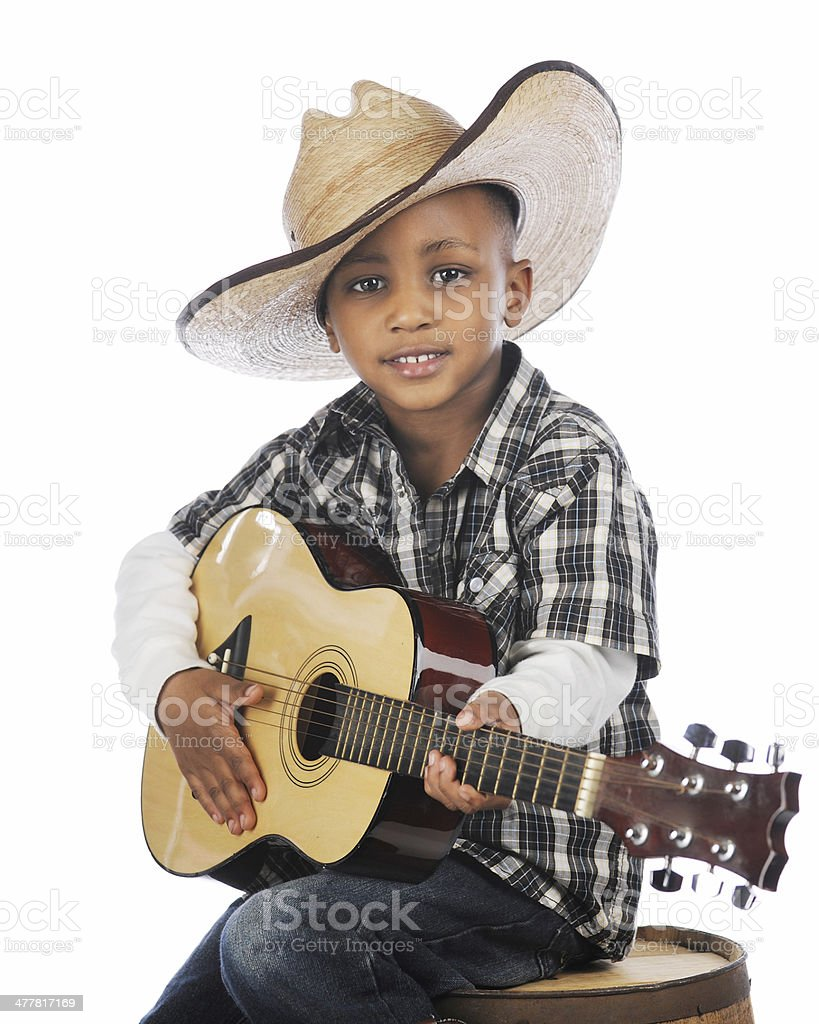 Young Strumming Cowboy royalty-free stock photo
