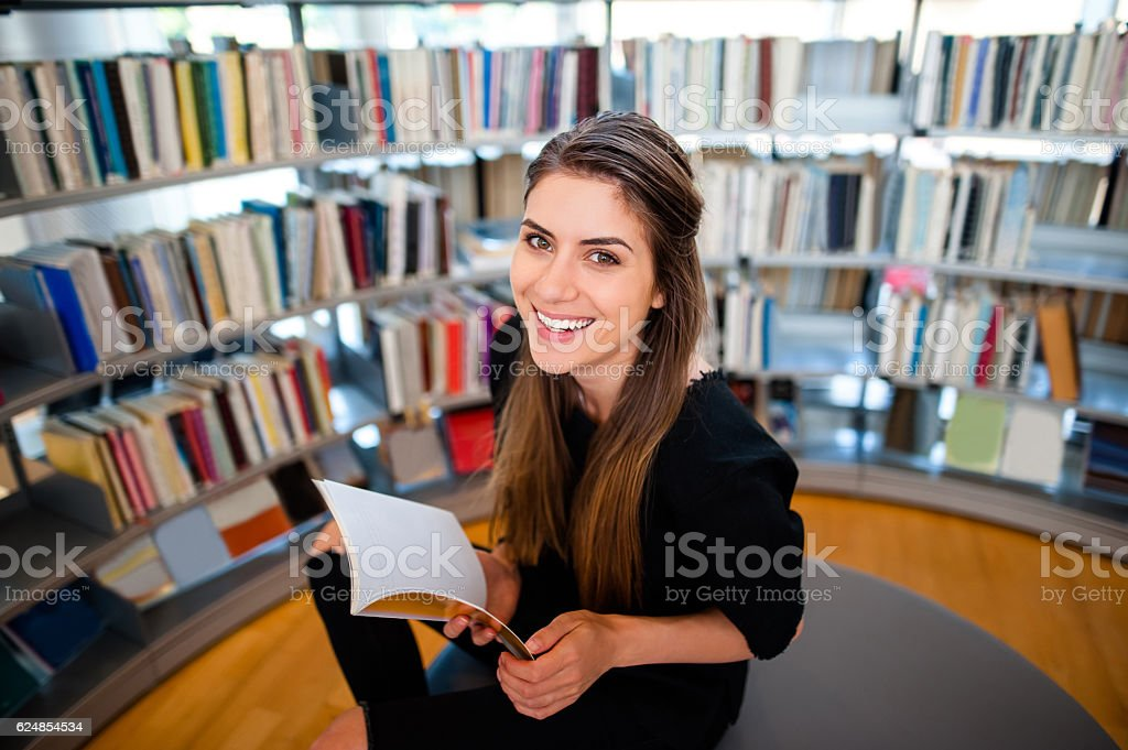 Young student girl in a library stock photo