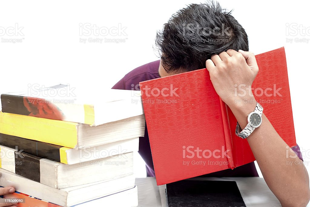 Young Student Hiding His Face with Book royalty-free stock photo