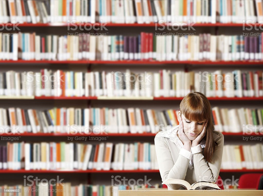 Young student in a library stock photo