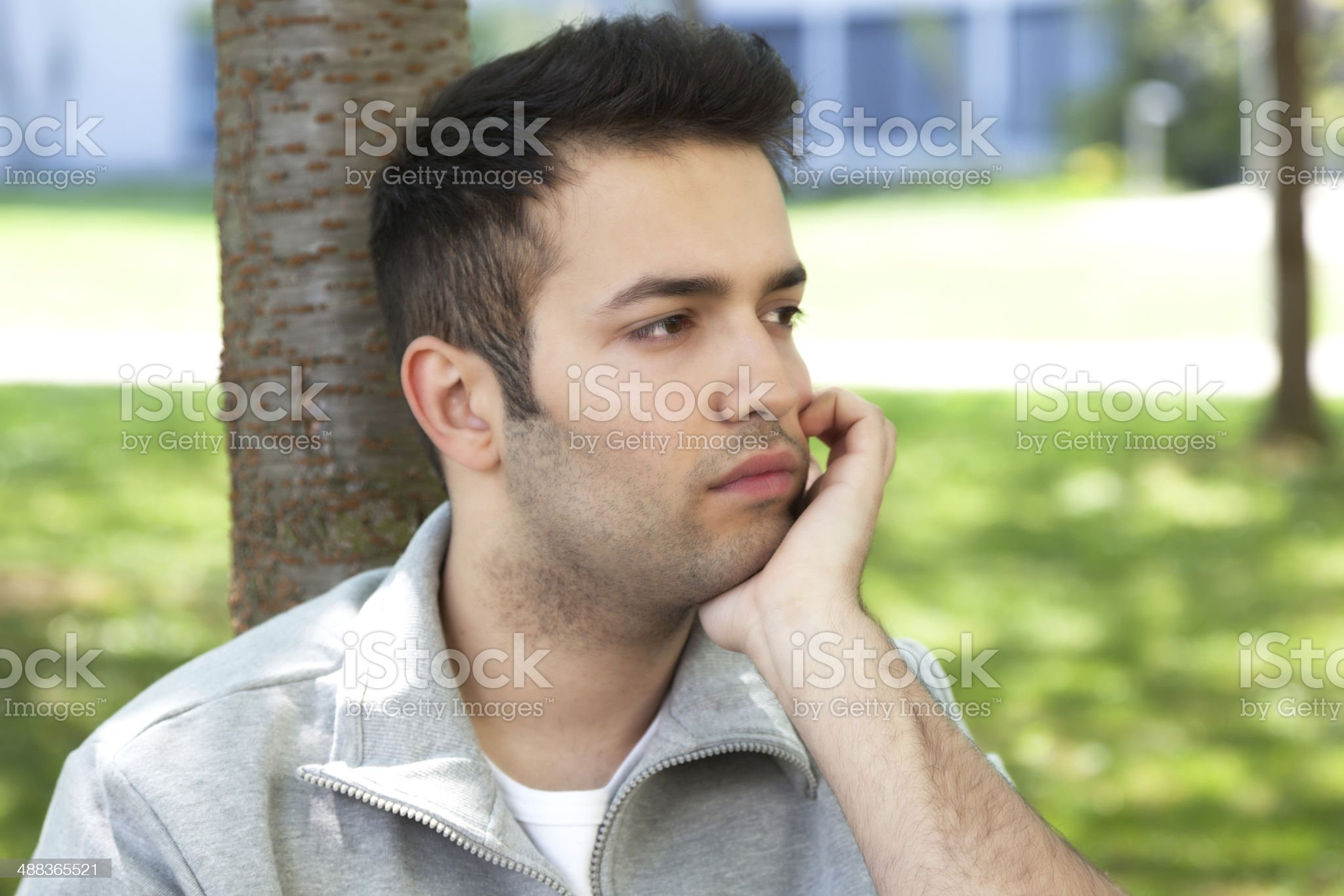 Young student in a park with depression royalty-free stock photo