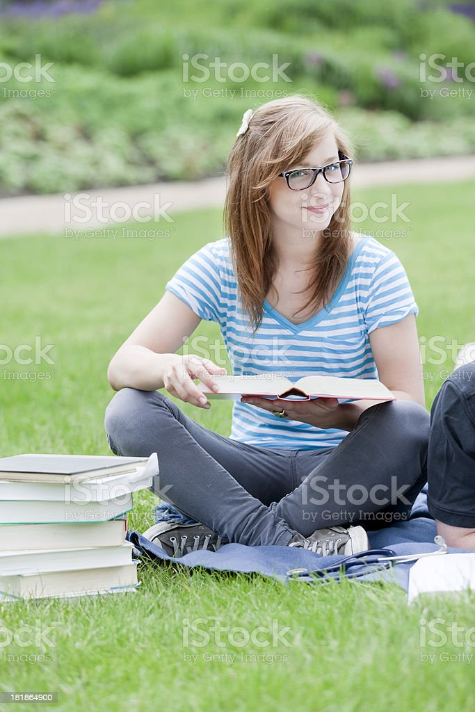 Young student learning outdoors royalty-free stock photo