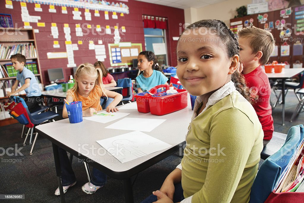 Young student looking forward in classroom stock photo