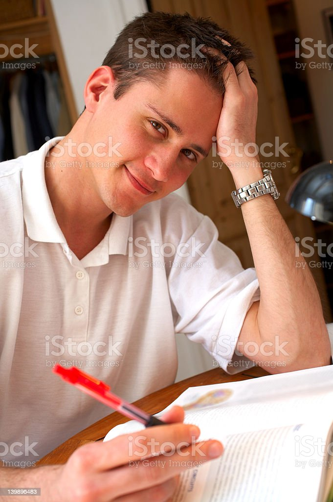 Young student reading and taking notes royalty-free stock photo