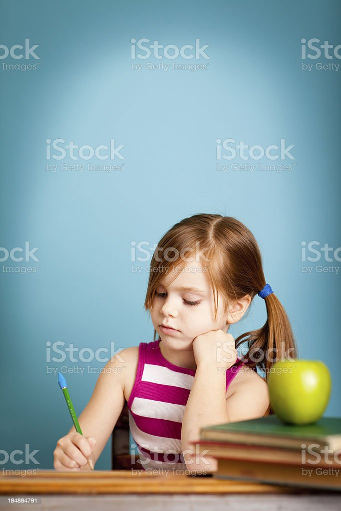 Young Student Sitting at Desk Doing Work, With Copy Space royalty-free stock photo