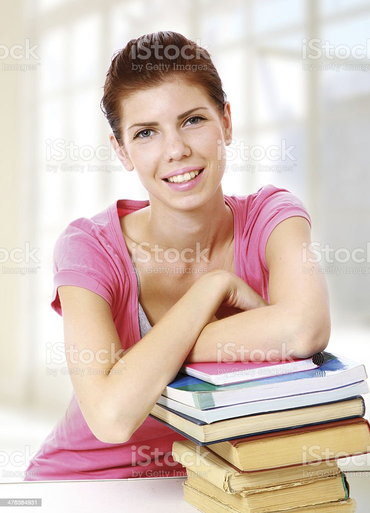 Young student sitting with book royalty-free stock photo