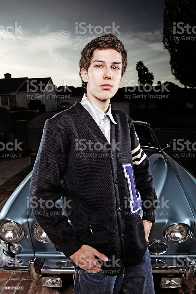 Young Student Standing by Vintage Car stock photo