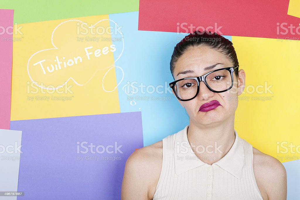Young Student Thinks Tuition Costs royalty-free stock photo