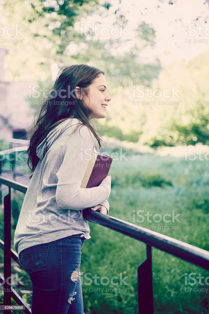 Young student walking outdoors stock photo