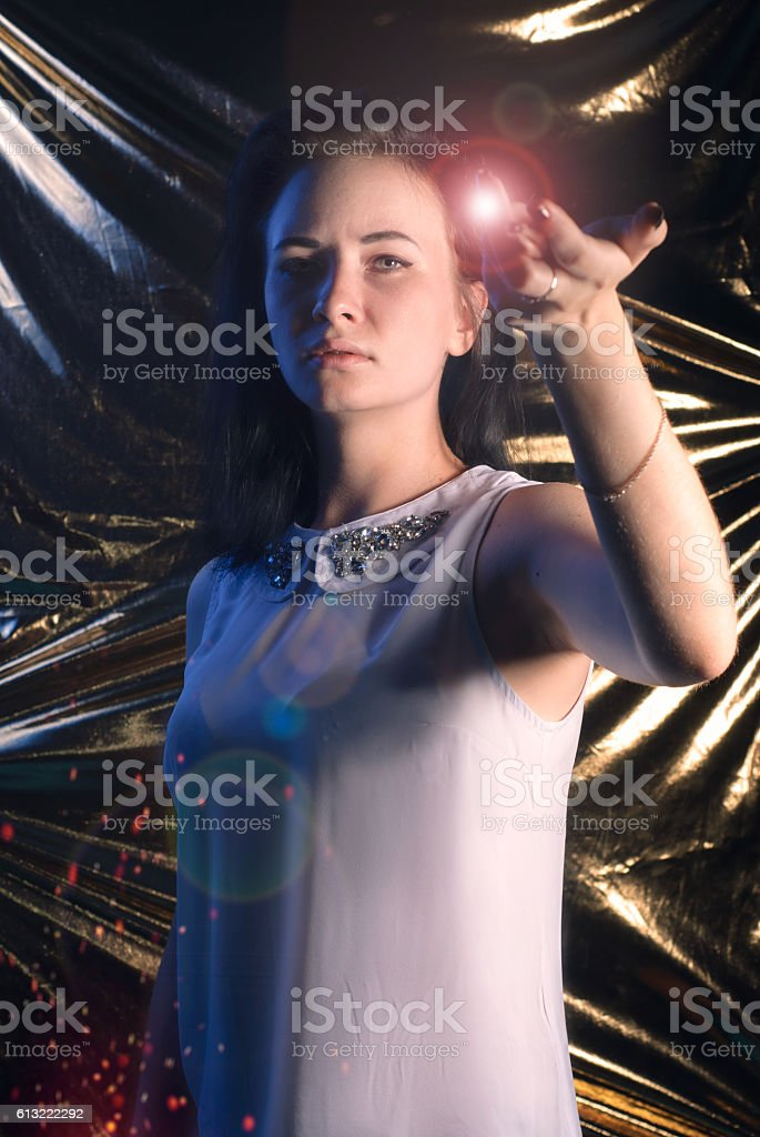 young student with a magic wand in hand stock photo