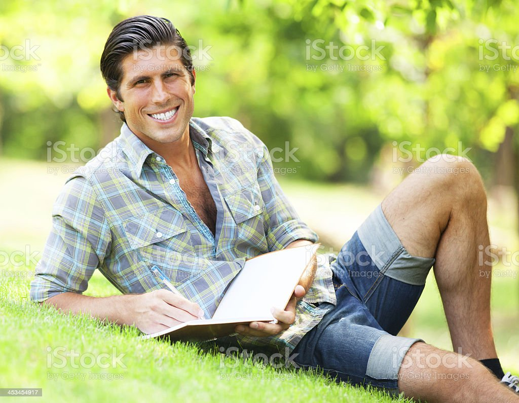 Young student with note at outdoor royalty-free stock photo