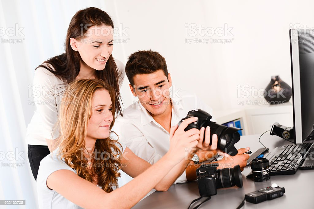young student with teacher during photography editing with computer camera stock photo