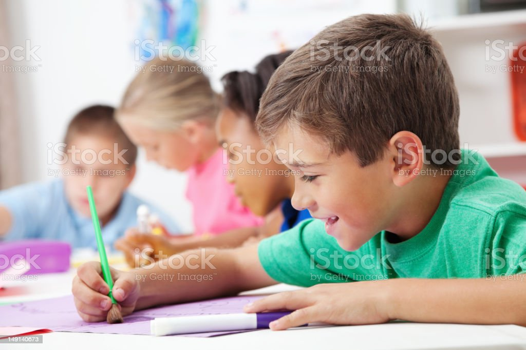 Young student working hard in art class royalty-free stock photo
