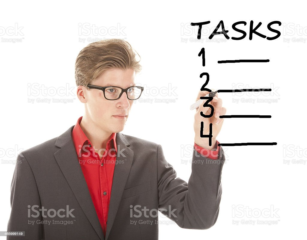 Young student writing tasks items isolated on white background stock photo