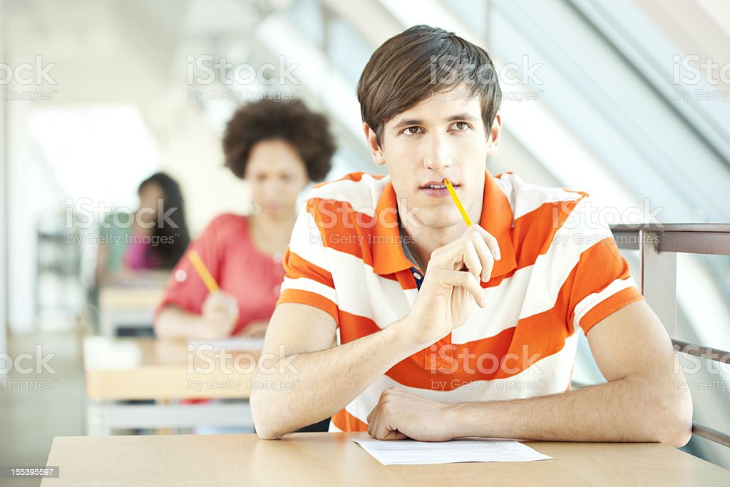 Young students at an exam stock photo
