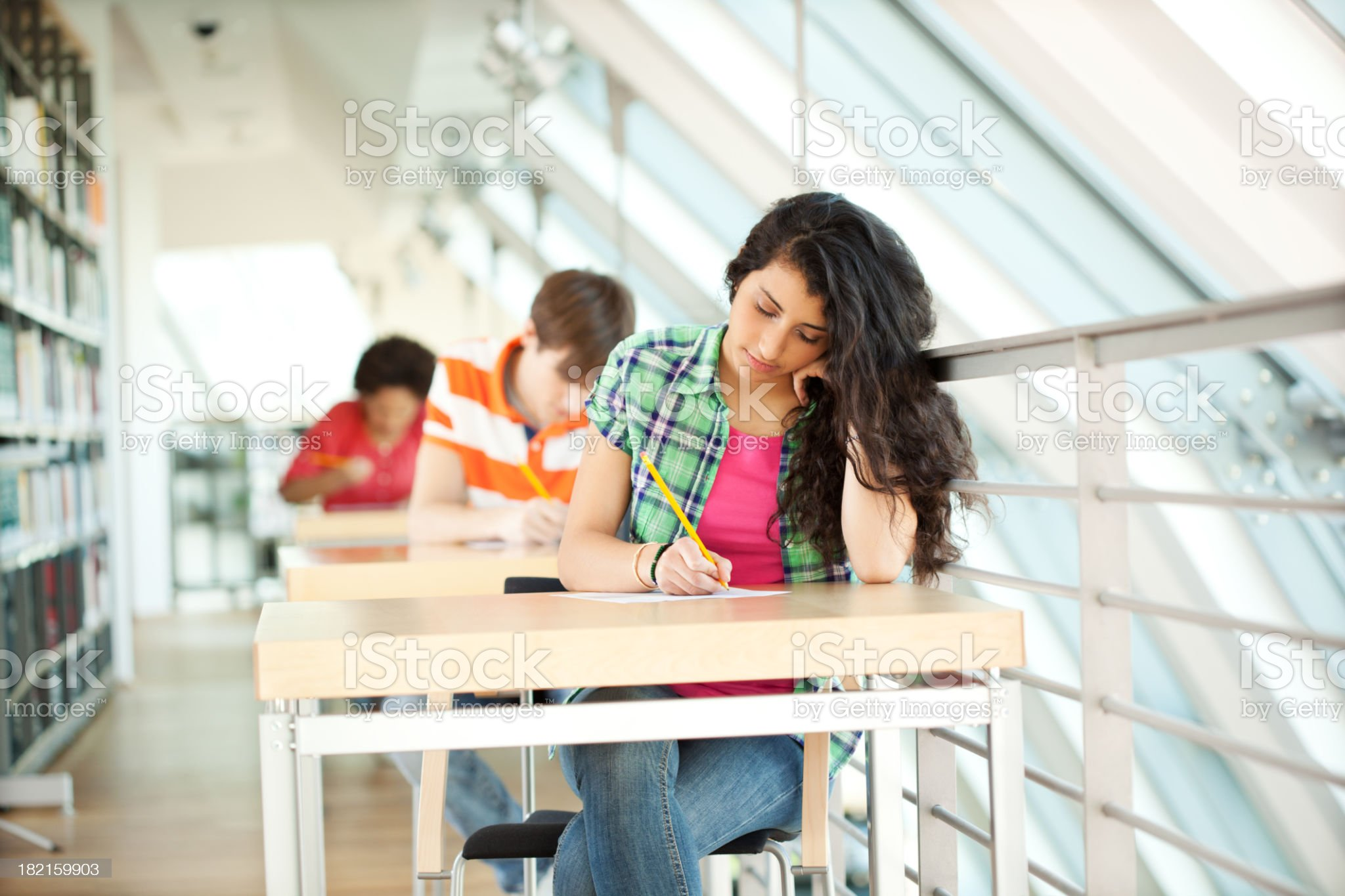 Young students at an exam royalty-free stock photo
