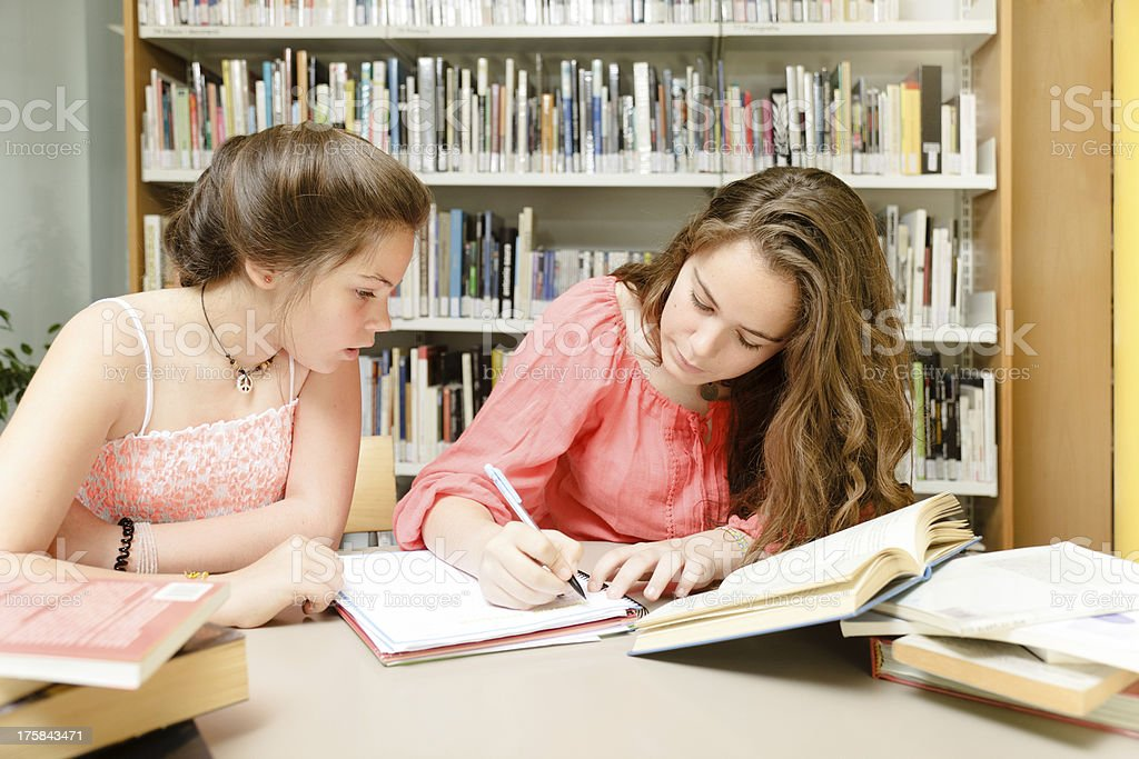 Young students at the library royalty-free stock photo