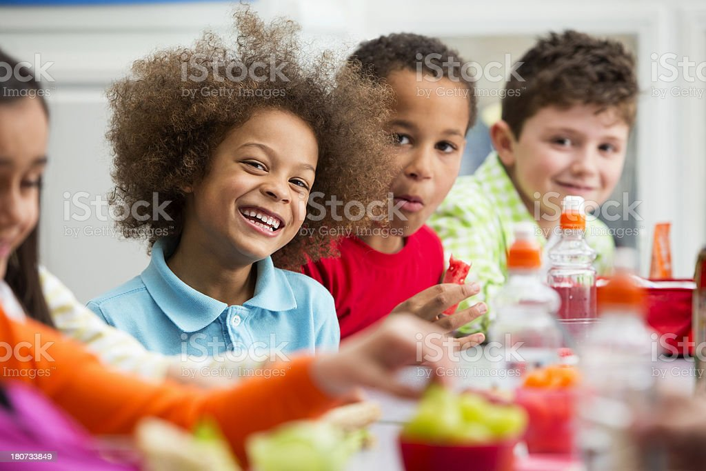 Young Students Enjoying Lunchtime royalty-free stock photo