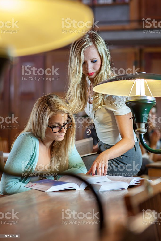 Young students in a college library stock photo