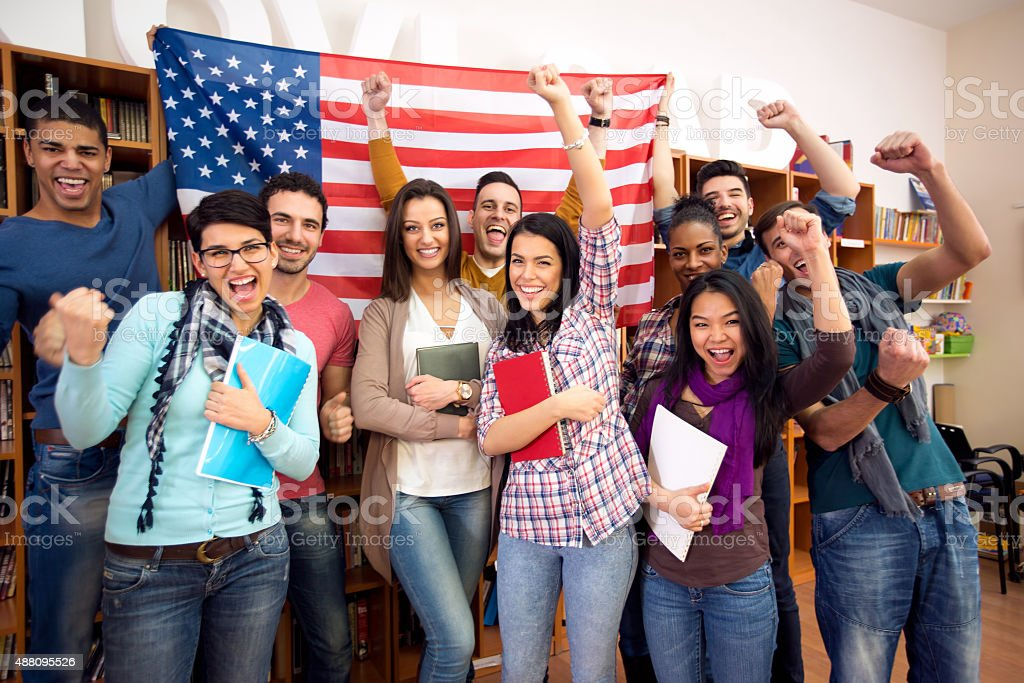 Young students presenting their country with flags stock photo