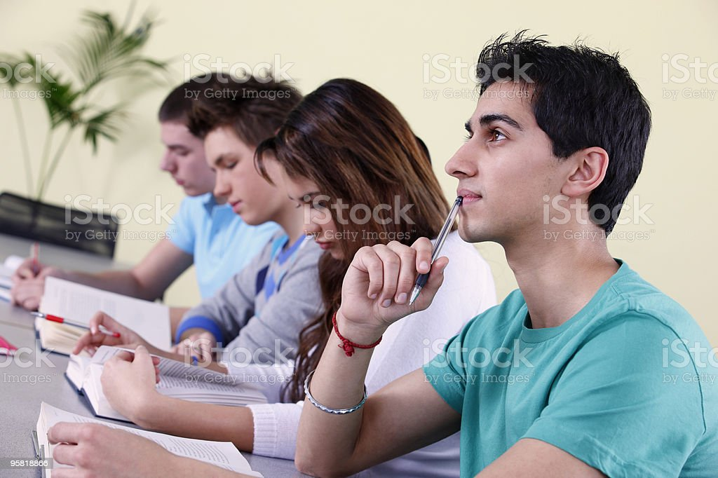 young students sitting an exam in a classroom at school royalty-free stock photo