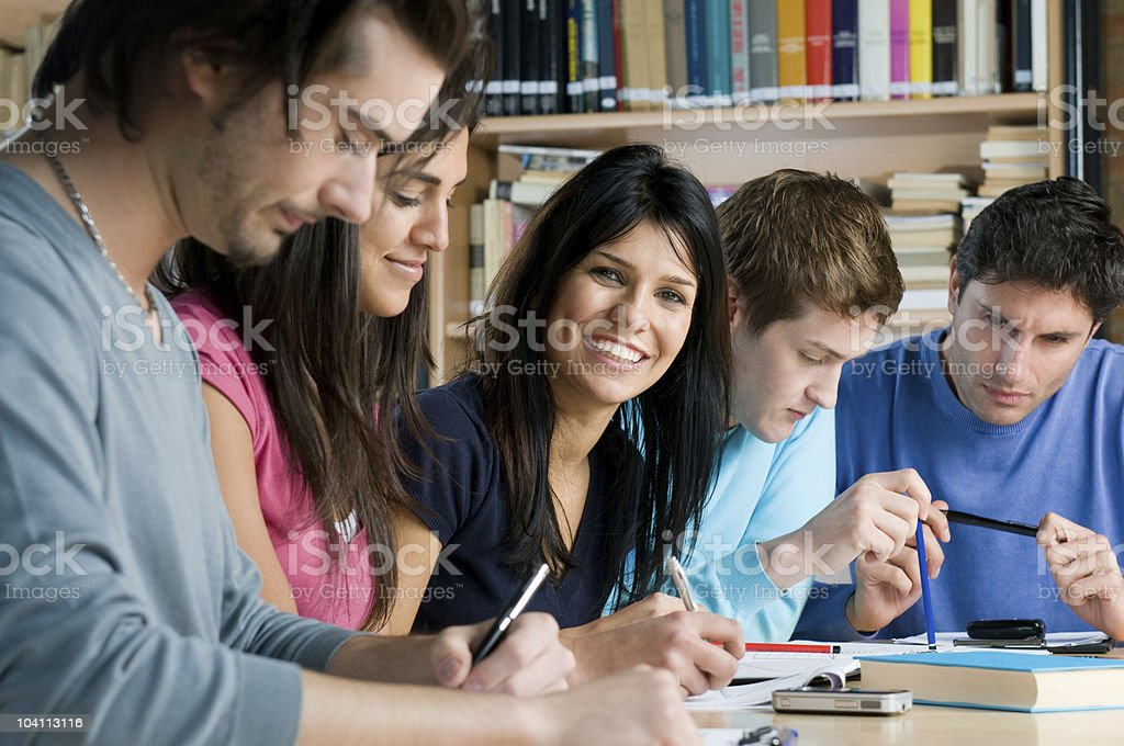 Young students studying in a library stock photo