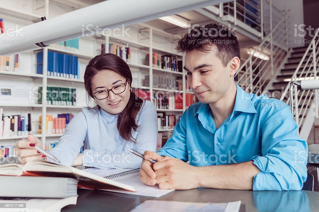 Young students studying in the library stock photo