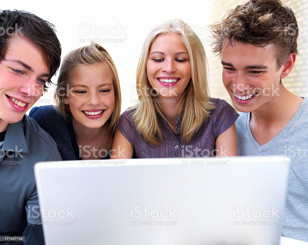 Young students working on computer royalty-free stock photo