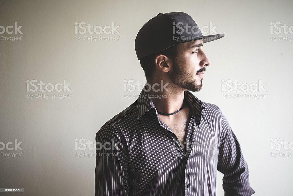 young stylish man with sport hat royalty-free stock photo