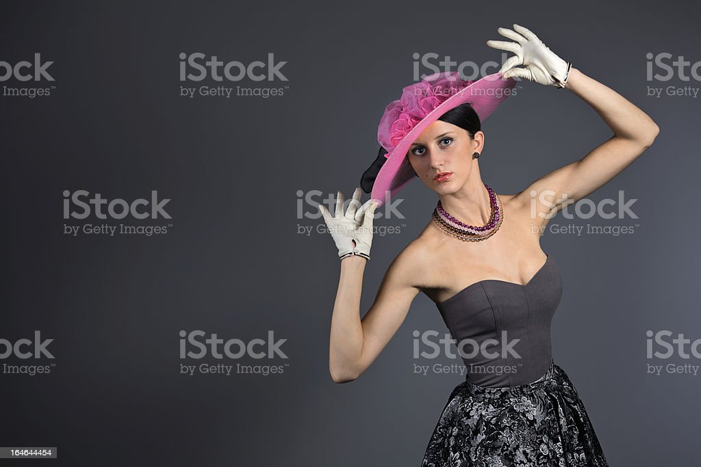 Young stylish woman with purple retro hat royalty-free stock photo