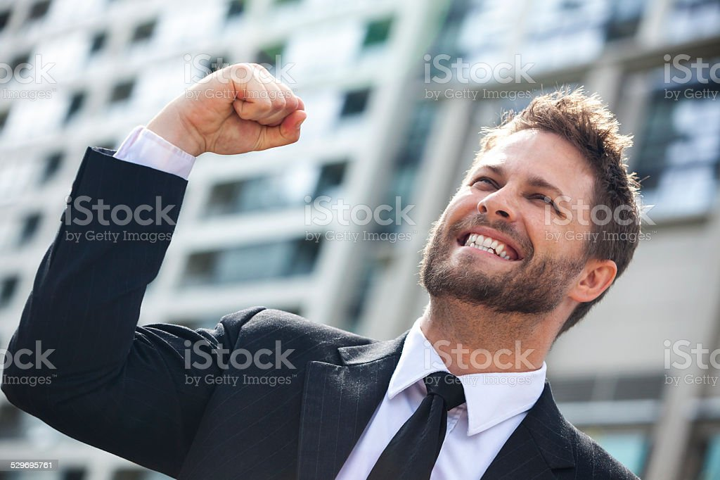 Young Successful Business Man Celebrating in City stock photo