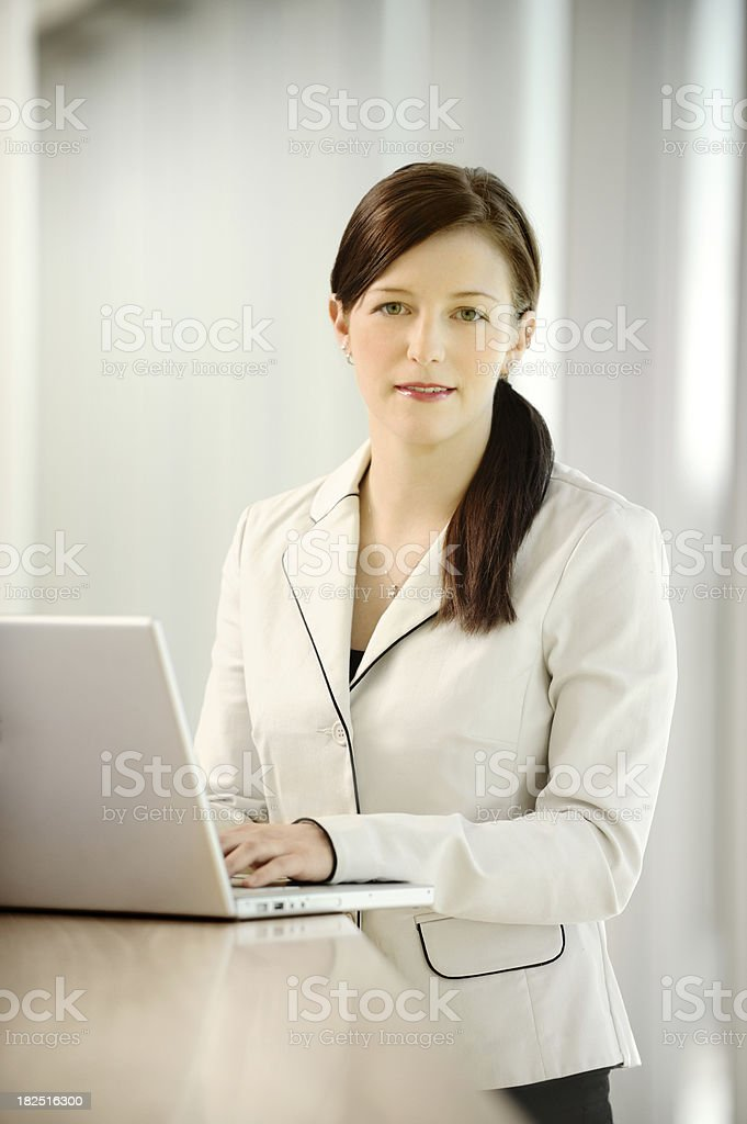 Young successful business woman working on a laptop royalty-free stock photo