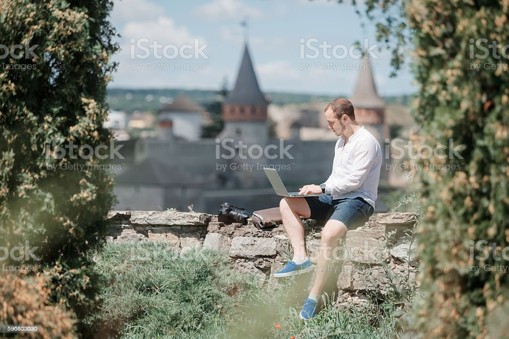 Young successful man working on laptop stock photo