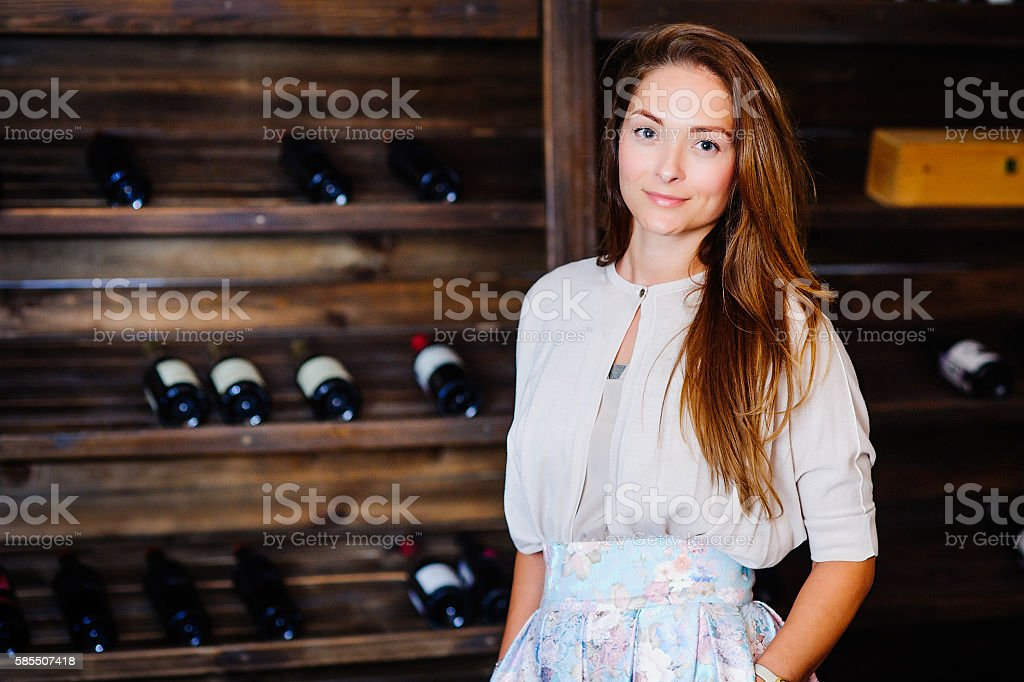 young successful woman winemaker stock photo