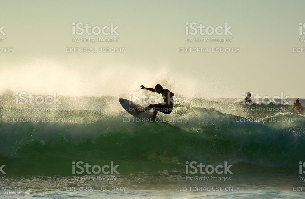 Young surfer surfing at Bondi beach stock photo