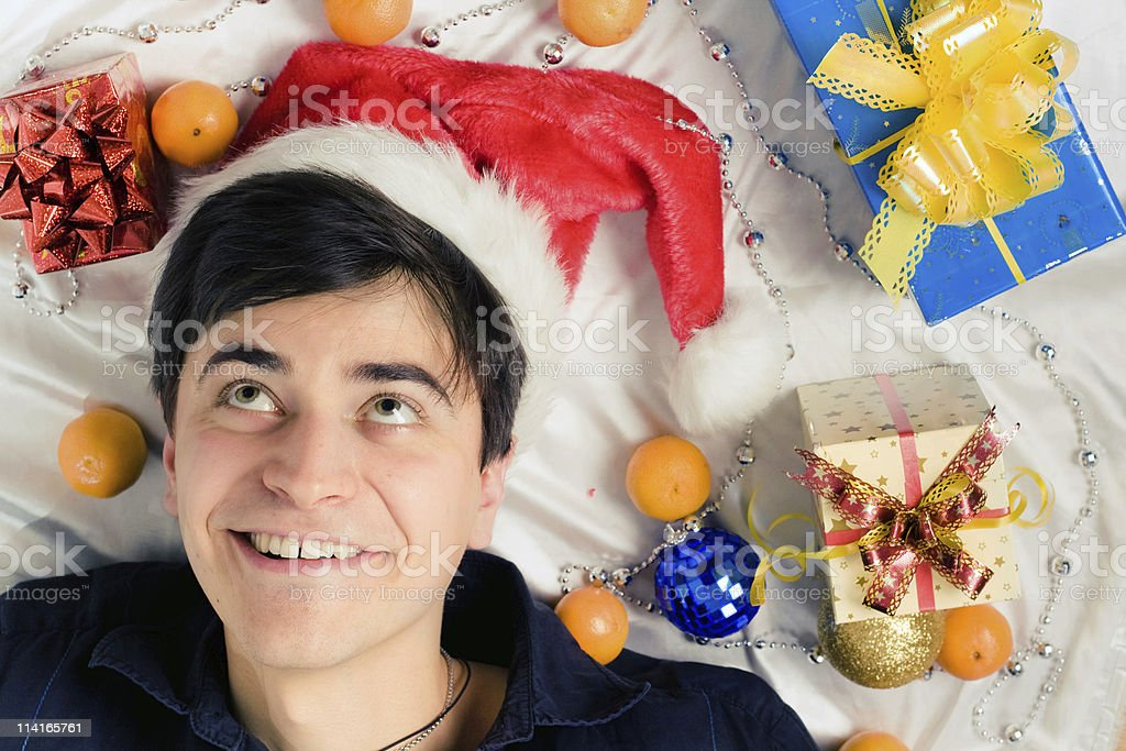 young surprised man in santa hat royalty-free stock photo