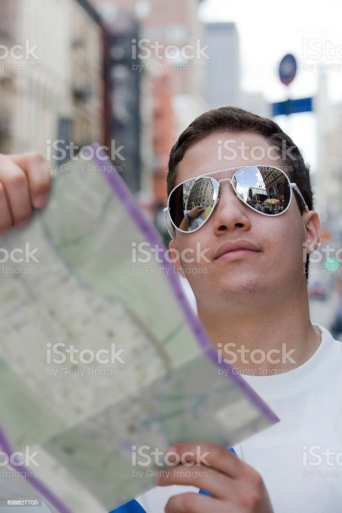 Young Swedish man holding map in downtown city stock photo